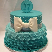 Aqua Ombre Petal Cake The design of this cake was specifically requested to mirror one from Fem Cakes. The bottom tier is a 10-inch with more than 200 ruffled...