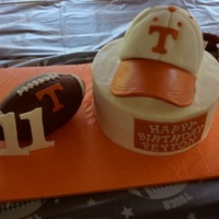 Tn Football Cake Made for my cousin's 11th birthday. The baseball cake is made from carved cake and sits on a 10-inch buttercream cake with fondant...