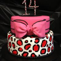 "Pink Leopard Print Cake Two-tier cake (8"" & 10"") covered in fondant with fondant/gumpaste bow and gumpaste '14.' The leopard print is hand..."