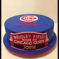 Chicago Cubs Birthday Cake Fondant over ganache with fondant Wrigley Field sign and Cubs logo.