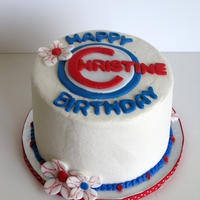 Feminine Chicago Cubs Birthday Cake   Chicago Cubs themed birthday cake covered in buttercream with fondant accents