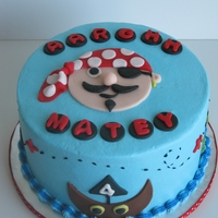 Pirate Birthday Cake   covered in buttercream with fondant accents