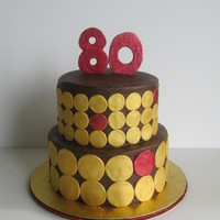 "80Th Birthday Cake 8"" and 10"" covered in dark chocolate buttercream with fondant accents"