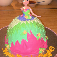 Tinkerbell Princess Cake Cake was vanilla WASC tinted pink, green and purple. Covered in Vanilla BC and decorations are all fondant. Thanks for all the inspirations...