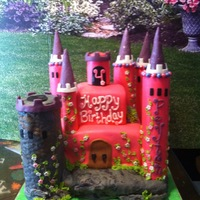 Pink Castle Cake cake was the sqare area, towers are rice crispie treats. All covered in fondant