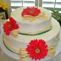 Gerber Daisy Country Bridal Shower This was for a country bridal shower and was my first attempt at gerber daisys. I used half gumpaste half fondant. I iced it in buttercream...