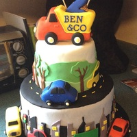 Cars, Trucks And Bus Cake Decorations made out of fondant and gumpaste. 3D cars, trucks and buses made out of rice crispy treats. Dump truck topper made out of rice...