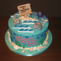 Under The Sea Buttercream cake with fondant accents and gumpaste decorations. Used a mold for the shells and waves are royal icing.
