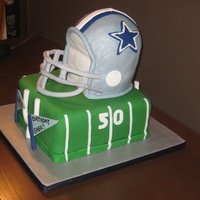Dallas Cowboys Helmet Fondant helmet on fondant field. First attempt at this type of cake