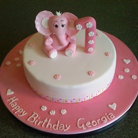 Baby Elelphant 1St Birthday Cake Single cake iced in fondant. Decorated with number 1, flowers and gumpaste elephant.