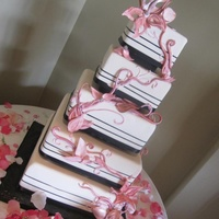 The Jessica Five tiered fondant wedding cake with hand crafted fondant flowers