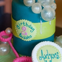 "Bubble Birthday 6"" Double barrel cake covered in Fondx with modeling chocolate accents and gelatin bubbles"