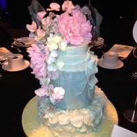 Featuring A Double Barrel With Stencil Design And A Multi Petal Design On The Bottom Tier And Featuring A Sugar Flower Spray Including Peon... Featuring a Double Barrel with stencil design and a multi petal design on the bottom tier and featuring a sugar flower spray including...