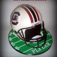 Go Gamecocks!  This cake is a true to size football helmet. It's 5 layers (about 2 in. each) of 10 inch rounds stacked. Two layers (with bubble tea...