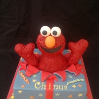 Elmo Cake Elmo cake. Elmo is made of rice krispy treat.