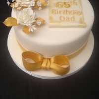 65Th Birthday Cake 65th birthday cake. Gold dusted flowers.