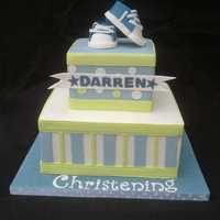Christening Cake Christening cake, fondant shoes and decorations.