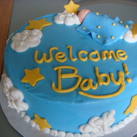 Welcome Baby Baby boy shower cake. Baby, blanket and stars made of fondant