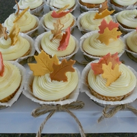 Fall Leaves Assorted cupcakes with Italian meringue buttercream and fondant leaves. Sprayed leaved with food glitter spray. Wrappers are tied with...