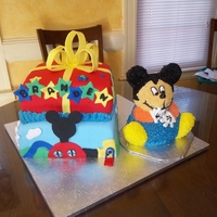 Mickey Mouse First Birthday This was for a first birthday.. bottom yellow w/bc and top layer was choc w/strawberry filling and bc... mickey himself was a crash cake...