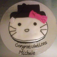 Hello Kitty Graduation Cake   Red Velvet Cake with Cream Cheese fillingCovered in Fondant