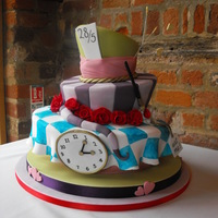 This Topsy Turvy Cake Has Details From Alice In Wonderland Including Half Painted Roses A Clock And Tail This topsy turvy cake has details from Alice in Wonderland including half painted roses, a clock and tail