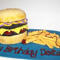 Burger & Chips Birthday Cake burger buns made in chocolate sponge cake covered with chocolate marzipan and sugarpaste