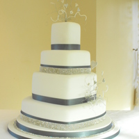 Diamante Wedding Cake Heart shaped wedding cake with diamante trim & clusters of wired sugar flowers & hearts