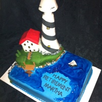 Lighthouse Retirement Cake Red velvet cake with chocolate cream cheese frosting. The lighthouse and house are RKT. All decorations are made from fondant.