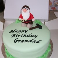 Grumpy Sponge cake with grumpy figure made fom gumpaste.