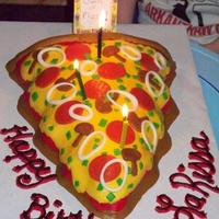 The Pizza Queen for my oldest. I used the Christmas tree pan. Iced in buttercreme and all 'toppings' are fondant.