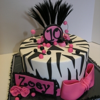 "Zebra/hot Pink 8"" round frosted with buttercream and fondant decorations."