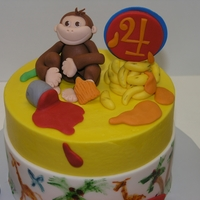 "Curious George 6"" frosted with buttercream and fondant decorations. Cupcakes to match."