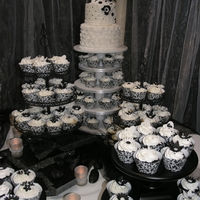 Black And White Wedding Small two tier cake with cupcakes to match.