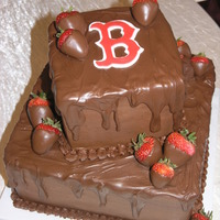Boston Red Sox 6 and 10 inch dark chocolate fudge cakes covered with chocolate fudge frosting and topped with chocolate ganache. Chocolate dipped...