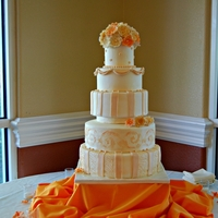 Ivory And Orange Wedding Cake This is my new favorite :) Serves about 250 people.. A picture was sent to me and I was asked to recreate with a few changes.. Gumpaste...