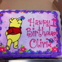 Winnie The Pooh First Birthday Cake 1/2 sheet Marble cake, 100% Buttercream frosting. My favorite kind of cakes to make! Freehand drawing of Pooh right on top of the cake......