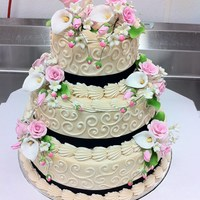 Ivory And Swirls Wedding Cake 3 Tier Stacked Wedding Cake: Double layers of 6, 10 and 12 inch white cake. Buttercream frosting in ivory (which ended up a little darker...