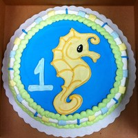 Seahorse First Birthday Cake 8 inch round cake, 100% Buttercream frosting. This cake was designed to match the theme of the party decor. I drew the seahorse freehand...