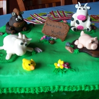 Hunters Baby Shower This was for my daughter-in-laws baby shower. It is a half chocolate half vanilla cake with buttercream icing. The farm animals are fondant...