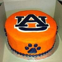 Auburn Tigers Orange Cream cheese with Navy blue fondant shapped into paw prints and I made a template for the AU sign and just cut it out.