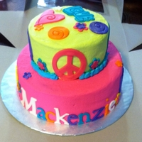 Love Peace tye dye cake inside, CC icing. Fondant accents. Used cookie cutters for cut outs and my cricut cake