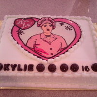 "Lucy & The Chocolate Factory  A sweet 16 cake for a young lady who is obsessed with ""I Love Lucy"". Lucy is a chocolate transfer. Conveyor belt is MMF...."