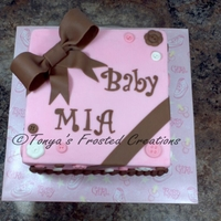 Pink & Brown Baby Shower Cake Cake covered in buttercream with fondant bow and buttons.