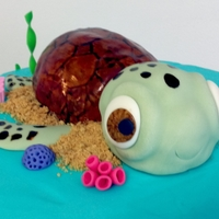 "Sea Turtle Ocean Theme Birthday Cake 10"" round ocean theme cake covered in buttercream. The sea turtle is made out of rice krispie treats & covered in fondant. All..."