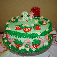 Strawberry Shortcake Strawberry shortcake themed cake with Butter cream and fondant accents.