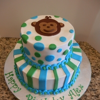 Mod Monkey! Mod monky themed tiered cake for a first birthday celeberation. WASC, buttercrean and fondant accents