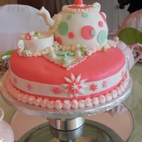 "Tea Time With Taylor! 12"" Round Fondant cake with gum paste and fondant accents.6"" ball pan made tea pot."