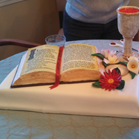 First Communion 2013 The base is chocolate cake covered in fondant. The bible is carved pound cake, with frosting and fondant. The text on the bible is an...
