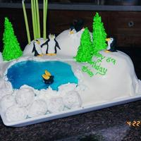 Penguin Birthday Cake This cake was made for a friend's little boy. The penguins were made out of fondant. The blue water was made from jello/knox blocks....